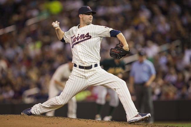 Sep 11, 2013; Minneapolis, MN, USA; Minnesota Twins relief pitcher Josh Roenicke (20) delivers a pitch in the fourth inning against the Oakland Athletics at Target Field. Mandatory Credit: Jesse Johnson-USA TODAY Sports