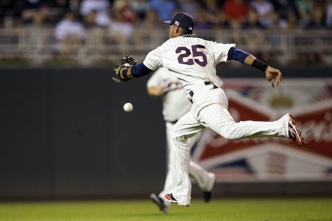 Sep 11, 2013; Minneapolis, MN, USA; Minnesota Twins shortstop Pedro Florimon (25) drops a ball fly ball in the fourth inning against the Oakland Athletics at Target Field. Mandatory Credit: Jesse Johnson-USA TODAY Sports