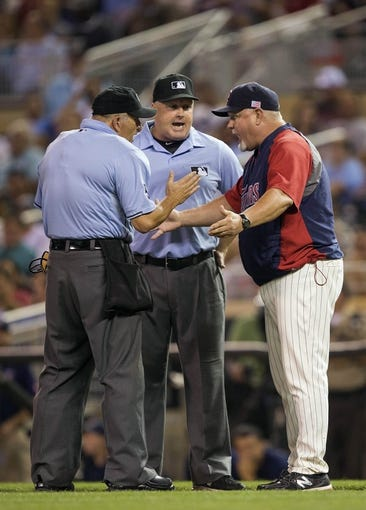 Sep 11, 2013; Minneapolis, MN, USA; Minnesota Twins manager Ron Gardenhire talks with home plate umpire Dale Scott and first base umpire Bill Miller during the fourth inning against the Oakland Athletics at Target Field. Mandatory Credit: Jesse Johnson-USA TODAY Sports