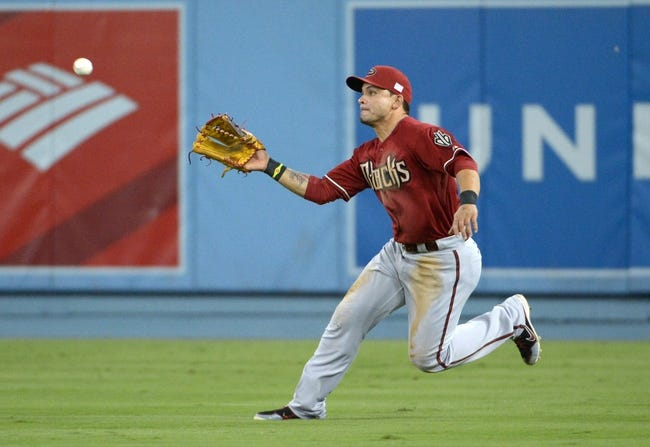 Sep 11, 2013; Los Angeles, CA, USA; Arizona Diamondbacks right fielder Gerardo Parra (8) catches a fly ball by Los Angeles Dodgers third baseman Michael Young (not pictured) in the second inning at Dodger Stadium. Mandatory Credit: Kirby Lee-USA TODAY Sports