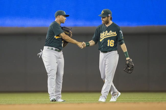 Sep 11, 2013; Minneapolis, MN, USA; Oakland Athletics center fielder Michael Choice (35) celebrates with right fielder Josh Reddick (16) after beating the Minnesota Twins at Target Field. The Athletics won 18-3. Mandatory Credit: Jesse Johnson-USA TODAY Sports