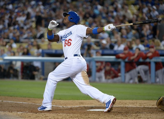 Sep 11, 2013; Los Angeles, CA, USA; Los Angeles Dodgers right fielder Yasiel Puig (66) bats during the game against the Arizona Diamondbacks at Dodger Stadium. The Diamondbacks defeated the Dodgers 4-1. Mandatory Credit: Kirby Lee-USA TODAY Sports