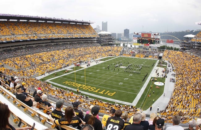 Sep 8, 2013; Pittsburgh, PA, USA; Fans file into the stands to watch the Pittsburgh Steelers host the Tennessee Titans at Heinz Field. The Tennessee Titans won 16-9. Mandatory Credit: Charles LeClaire-USA TODAY Sports