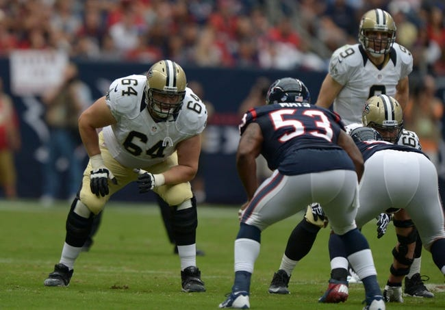 Aug 25, 2013; Houston, TX, USA; New Orleans Saints tackle Zach Strief (64) lines up against Houston Texans linebacker Joey Mays (53) at Reliant Stadium. Mandatory Credit: Kirby Lee-USA TODAY Sports