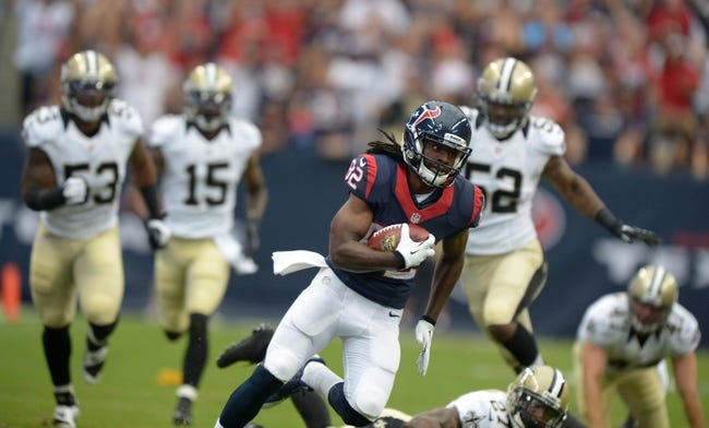 Aug 25, 2013; Houston, TX, USA; Houston Texans receiver Keyshawn Martin (82) carries the ball against the New Orleans Saints at Reliant Stadium. Mandatory Credit: Kirby Lee-USA TODAY Sports