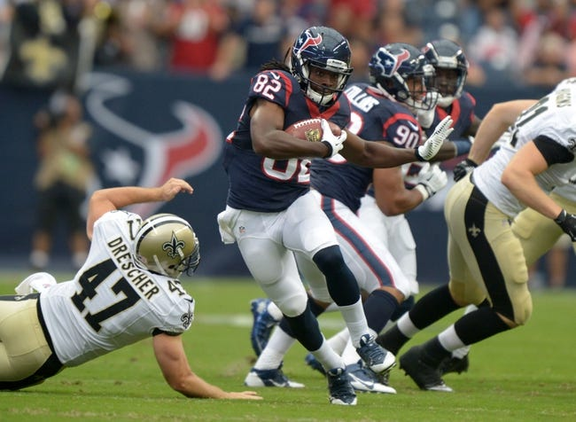 Aug 25, 2013; Houston, TX, USA; Houston Texans receiver Keshawn Martin (82) is defended by New Orleans Saints player Justin Drescher (47) at Reliant Stadium. Mandatory Credit: Kirby Lee-USA TODAY Sports