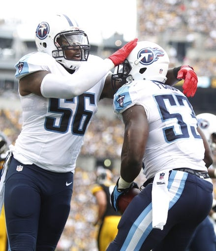 Sep 8, 2013; Pittsburgh, PA, USA; Tennessee Titans outside linebacker Akeem Ayers (56) and inside linebacker Moise Fokou (53) celebrate after Fokou recovered a fumble against the Pittsburgh Steelers during the first quarter at Heinz Field. The Tennessee Titans won 16-9. Mandatory Credit: Charles LeClaire-USA TODAY Sports