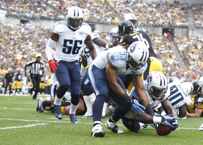 Sep 8, 2013; Pittsburgh, PA, USA; Tennessee Titans inside linebacker Moise Fokou (right) recovers the ball in the end-zone ahead of free safety Michael Griffin (33) after a fumble by Pittsburgh Steelers running back Isaac Redman (not pictured) during the first quarter at Heinz Field. The Tennessee Titans won 16-9. Mandatory Credit: Charles LeClaire-USA TODAY Sports