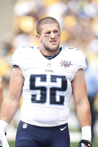 Sep 8, 2013; Pittsburgh, PA, USA; Tennessee Titans middle linebacker Colin McCarthy (52) looks on from the sidelines against the Pittsburgh Steelers during the second quarter at Heinz Field. The Tennessee Titans won 16-9. Mandatory Credit: Charles LeClaire-USA TODAY Sports