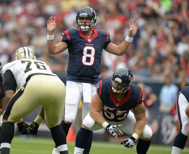 Aug 25, 2013; Houston, TX, USA; Houston Texans quarterback Matt Schaub (8) prepares to take the snap from center Chris Myers (55) during the game against the New Orleans Saints at Reliant Stadium. Mandatory Credit: Kirby Lee-USA TODAY Sports