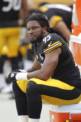 Sep 8, 2013; Pittsburgh, PA, USA; Pittsburgh Steelers linebacker Jarvis Jones (95) looks on from the sidelines against the Tennessee Titans during the third quarter at Heinz Field. The Tennessee Titans won 16-9. Mandatory Credit: Charles LeClaire-USA TODAY Sports