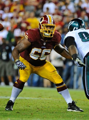 Sep 9, 2013; Landover, MD, USA; Washington Redskins guard Chris Chester (66) prepares to block against the Philadelphia Eagles during the second half at FedEX Field. The Eagles won 33 - 27. Mandatory Credit: Brad Mills-USA TODAY Sports