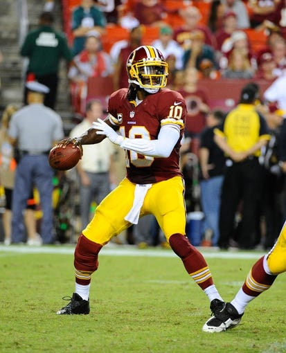 Sep 9, 2013; Landover, MD, USA; Washington Redskins quarterback Robert Griffin III (10) drops back to pass against the Philadelphia Eagles during the second half at FedEX Field. The Eagles won 33 - 27. Mandatory Credit: Brad Mills-USA TODAY Sports