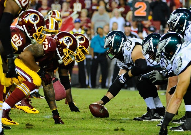 Sep 9, 2013; Landover, MD, USA; General view of the line of scrimmage during the game between the Washington Redskins and Philadelphia Eagles at FedEX Field. The Eagles won 33 - 27. Mandatory Credit: Brad Mills-USA TODAY Sports