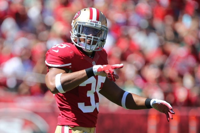 Sep 8, 2013; San Francisco, CA, USA; San Francisco 49ers safety Eric Reid (35) reacts after a play against the Green Bay Packers during the first quarter at Candlestick Park. Mandatory Credit: Kelley L Cox-USA TODAY Sports