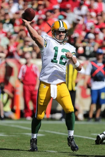 Sep 8, 2013; San Francisco, CA, USA; Green Bay Packers quarterback Aaron Rodgers (12) looks during the third quarter at Candlestick Park. The San Francisco 49ers defeated the Green Bay Packers 34-28. Mandatory Credit: Kelley L Cox-USA TODAY Sports
