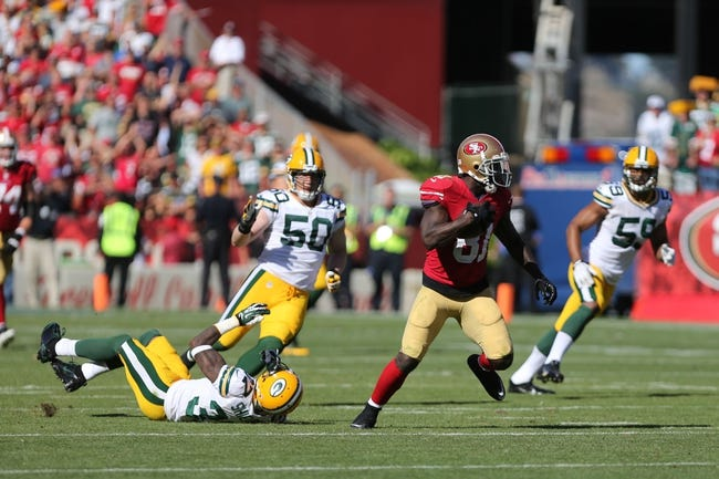 Sep 8, 2013; San Francisco, CA, USA; San Francisco 49ers wide receiver Anquan Boldin (81) escapes a tackle by Green Bay Packers cornerback Sam Shields (37) on a carry during the fourth quarter at Candlestick Park. The San Francisco 49ers defeated the Green Bay Packers 34-28. Mandatory Credit: Kelley L Cox-USA TODAY Sports
