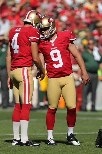 Sep 8, 2013; San Francisco, CA, USA; San Francisco 49ers kicker Phil Dawson (9) celebrate with holder/punter Andy Lee (4) after kicking a field goal against the Green Bay Packers during the fourth quarter at Candlestick Park. The San Francisco 49ers defeated the Green Bay Packers 34-28. Mandatory Credit: Kelley L Cox-USA TODAY Sports