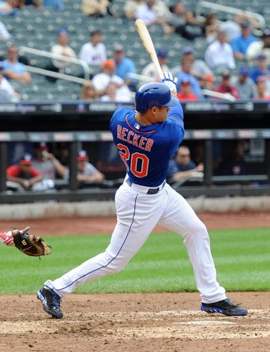 Sep 12, 2013; New York, NY, USA; New York Mets catcher Anthony Recker (20) hits an RBI single during the fourth inning against the Washington Nationals at Citi Field. Mandatory Credit: Joe Camporeale-USA TODAY Sports