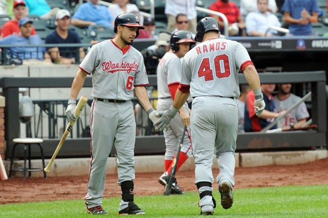 Sep 12, 2013; New York, NY, USA; Washington Nationals catcher Wilson Ramos (40) is congratulated by second baseman Anthony Rendon (6) after hitting a home run against the New York Mets during the fifth inning at Citi Field. Mandatory Credit: Joe Camporeale-USA TODAY Sports