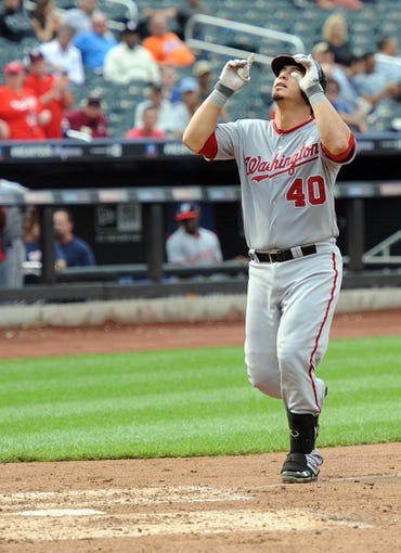 Sep 12, 2013; New York, NY, USA; Washington Nationals catcher Wilson Ramos (40) celebrates after hitting a home run against the New York Mets during the fifth inning at Citi Field. Mandatory Credit: Joe Camporeale-USA TODAY Sports
