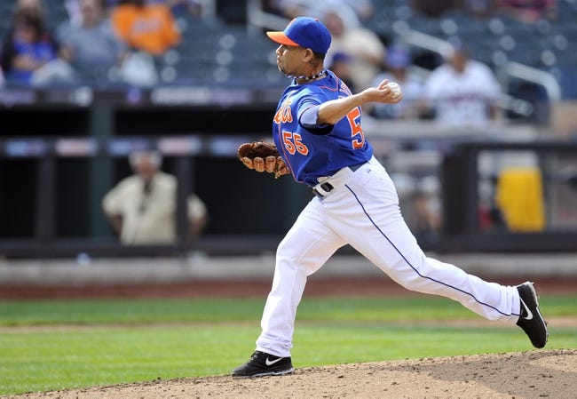 Sep 12, 2013; New York, NY, USA; New York Mets relief pitcher Pedro Feliciano (55) throws a pitch during the seventh inning against the Washington Nationals at Citi Field. Mandatory Credit: Joe Camporeale-USA TODAY Sports