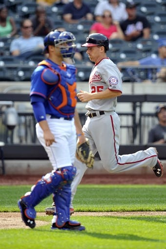 Sep 12, 2013; New York, NY, USA; Washington Nationals first baseman Adam LaRoche (25) scores on a sacrifice fly by second baseman Anthony Rendon (not pictured) during the seventh inning against the New York Mets at Citi Field. Mandatory Credit: Joe Camporeale-USA TODAY Sports