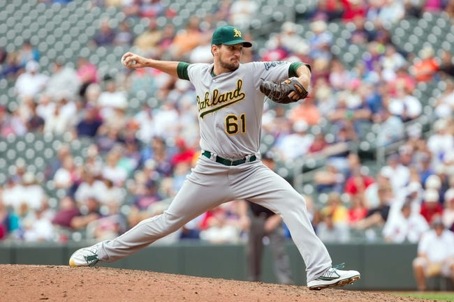 Sep 12, 2013; Minneapolis, MN, USA; Oakland Athletics pitcher Dan Otero (61) throws a pitch in the eighth inning against the Minnesota Twins at Target Field. Mandatory Credit: Brad Rempel-USA TODAY Sports