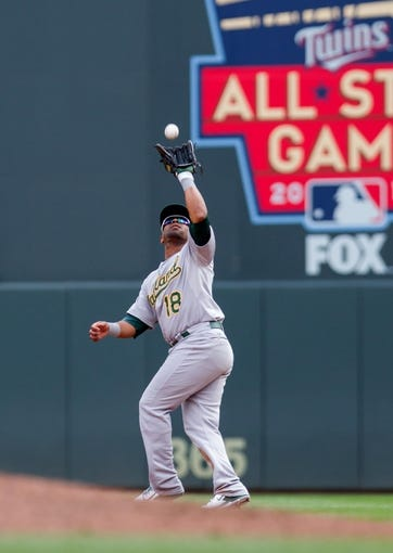 Sep 12, 2013; Minneapolis, MN, USA; Oakland Athletics infield Alberto Callaspo (18) catches a fly ball in the seventh inning against the Minnesota Twins at Target Field. Mandatory Credit: Brad Rempel-USA TODAY Sports