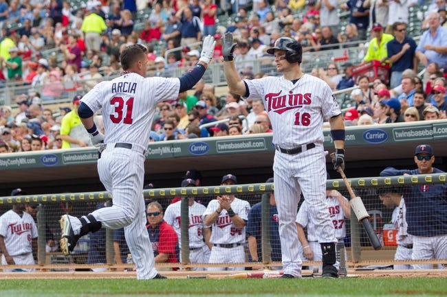 Sep 12, 2013; Minneapolis, MN, USA; Minnesota Twins outfielder Oswaldo Arcia (31) gets congratulated by designated hitter left fielder Josh Willingham (16) after his home run in the eighth inning against the Oakland Athletics at Target Field. Mandatory Credit: Brad Rempel-USA TODAY Sports