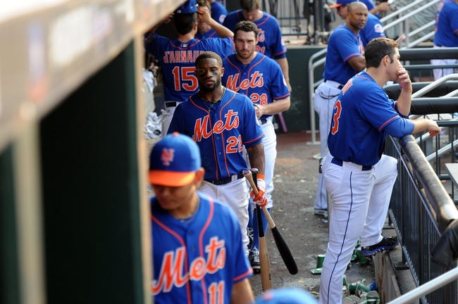Sep 12, 2013; New York, NY, USA; New York Mets players leave the dugout after being defeated by the Washington Nationals at Citi Field. The Nationals won the game 7-2. Mandatory Credit: Joe Camporeale-USA TODAY Sports