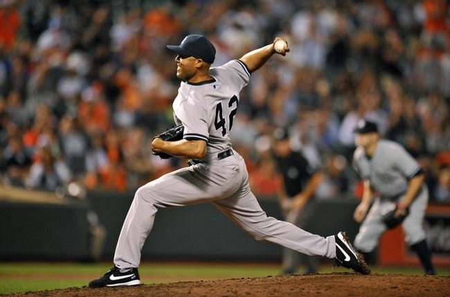 Sep 12, 2013; Baltimore, MD, USA; New York Yankees pitcher Mariano Rivera (42) throws in the ninth inning against the Baltimore Orioles at Oriole Park at Camden Yards. The Yankees defeated the Orioles 6-5. Mandatory Credit: Joy R. Absalon-USA TODAY Sports