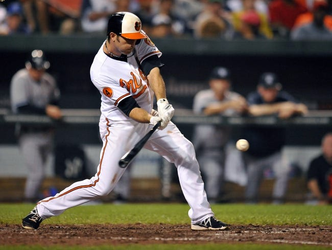 Sep 12, 2013; Baltimore, MD, USA; Baltimore Orioles shortstop J.J. Hardy (2) singles in the seventh inning against the New York Yankees at Oriole Park at Camden Yards. The Yankees defeated the Orioles 6-5. Mandatory Credit: Joy R. Absalon-USA TODAY Sports