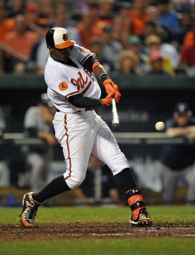 Sep 12, 2013; Baltimore, MD, USA; Baltimore Orioles center fielder Adam Jones (10) singles in the eighth inning against the New York Yankees at Oriole Park at Camden Yards. The Yankees defeated the Orioles 6-5. Mandatory Credit: Joy R. Absalon-USA TODAY Sports