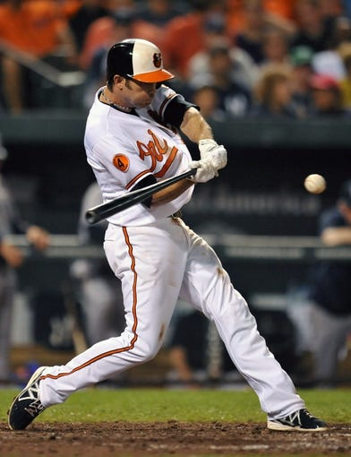 Sep 12, 2013; Baltimore, MD, USA; Baltimore Orioles shortstop J.J. Hardy (2) doubles in the eighth inning against the New York Yankees at Oriole Park at Camden Yards. The Yankees defeated the Orioles 6-5. Mandatory Credit: Joy R. Absalon-USA TODAY Sports