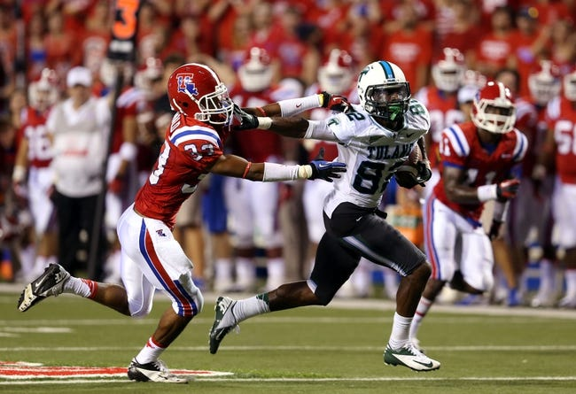 Sep 12, 2013; Ruston, LA, USA; Tulane Green Wave wide receiver Xavier Rush (82) gets away from Louisiana Tech Bulldogs safety Thomas McDonald (33) on his way to a 38-yard touchdown in the third quarter at Joe Aillet Stadium. Tulane won, 24-15. Mandatory Credit: Chuck Cook-USA TODAY Sports