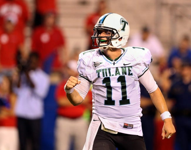 Sep 12, 2013; Ruston, LA, USA; Tulane Green Wave quarterback Nick Montana (11) gestures after his team scored a touchdown against the Louisiana Tech Bulldogs in the fourth quarter at Joe Aillet Stadium. Tulane won, 24-15. Mandatory Credit: Chuck Cook-USA TODAY Sports
