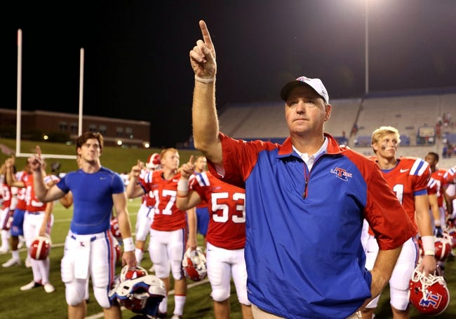 Sep 12, 2013; Ruston, LA, USA; Louisiana Tech Bulldogs head coach Skip Holtz listens to the band play the school alma mater at the end of their game against the Tulane Green Wave at Joe Aillet Stadium. Tulane won, 24-15. Mandatory Credit: Chuck Cook-USA TODAY Sports