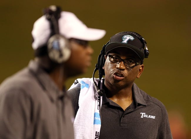 Sep 12, 2013; Ruston, LA, USA; Tulane Green Wave head coach Curtis Johnson talks to an assistant during their game against the Louisiana Tech Bulldogs in the second quarter at Joe Aillet Stadium. Mandatory Credit: Chuck Cook-USA TODAY Sports