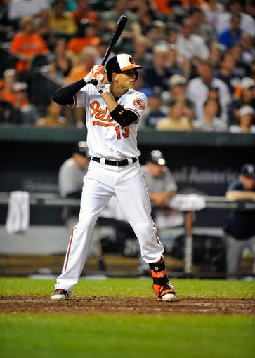 Sep 10, 2013; Baltimore, MD, USA; Baltimore Orioles third baseman Manny Machado (13) bats in the seventh inning against the New York Yankees at Oriole Park at Camden Yards. The Yankees defeated the Orioles 7-5. Mandatory Credit: Joy R. Absalon-USA TODAY Sports