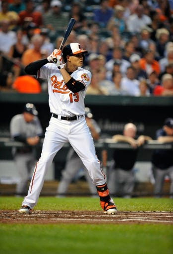 Sep 10, 2013; Baltimore, MD, USA; Baltimore Orioles third baseman Manny Machado (13) bats in the first inning against the New York Yankees at Oriole Park at Camden Yards. The Yankees defeated the Orioles 7-5. Mandatory Credit: Joy R. Absalon-USA TODAY Sports