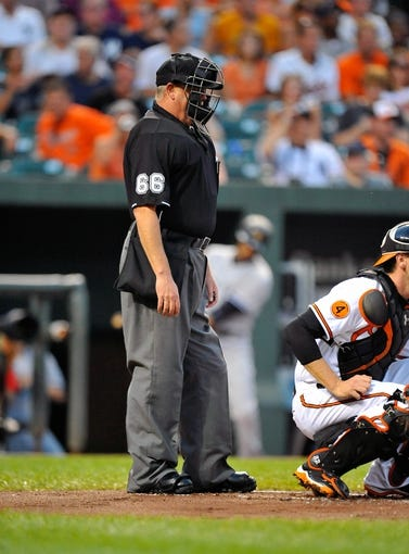Sep 10, 2013; Baltimore, MD, USA; Home plate umpire Jim Joyce during a game between the New York Yankees and the Baltimore Orioles at Oriole Park at Camden Yards. The Yankees defeated the Orioles 7-5. Mandatory Credit: Joy R. Absalon-USA TODAY Sports