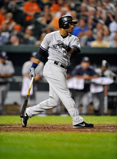 Sep 10, 2013; Baltimore, MD, USA; New York Yankees second baseman Robinson Cano (24) bats in the eighth inning against the Baltimore Orioles at Oriole Park at Camden Yards. The Yankees defeated the Orioles 7-5. Mandatory Credit: Joy R. Absalon-USA TODAY Sports