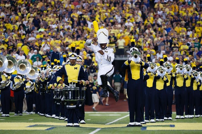 Sep 7, 2013; Ann Arbor, MI, USA; Michigan Wolverines drum major Jeffrey Okala with the marching band before the game against the Notre Dame Fighting Irish at Michigan Stadium. Mandatory Credit: Rick Osentoski-USA TODAY Sports