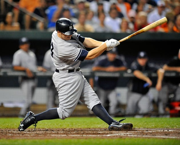 Sep 10, 2013; Baltimore, MD, USA; New York Yankees first baseman Mark Reynolds (39) bats in the second inning against the Baltimore Orioles at Oriole Park at Camden Yards. The Yankees defeated the Orioles 7-5. Mandatory Credit: Joy R. Absalon-USA TODAY Sports