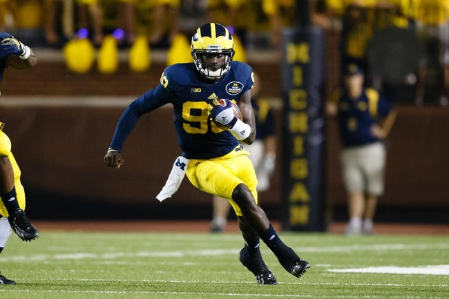 Sep 7, 2013; Ann Arbor, MI, USA; Michigan Wolverines quarterback Devin Gardner (98) runs the ball against the Notre Dame Fighting Irish at Michigan Stadium. Mandatory Credit: Rick Osentoski-USA TODAY Sports