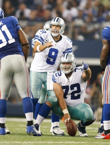 Sep 8, 2013; Arlington, TX, USA; Dallas Cowboys quarterback Tony Romo (9) and center Travis Frederick (72) call a play at the line of scrimmage against the New York Giants at AT&T Stadium. The Dallas Cowboys beat the New York Giants 36-31. Mandatory Credit: Tim Heitman-USA TODAY Sports