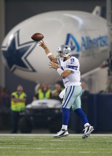 Sep 8, 2013; Arlington, TX, USA; Dallas Cowboys quarterback Tony Romo (9) throws a pass during the game against the New York Giants  at AT&T Stadium. The Dallas Cowboys beat the New York Giants 36-31. Mandatory Credit: Tim Heitman-USA TODAY Sports