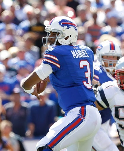 Sep 8, 2013; Orchard Park, NY, USA; Buffalo Bills quarterback EJ Manuel (3) during the game against the New England Patriots at Ralph Wilson Stadium. Patriots beat the Bills 23-21. Mandatory Credit: Kevin Hoffman-USA TODAY Sports