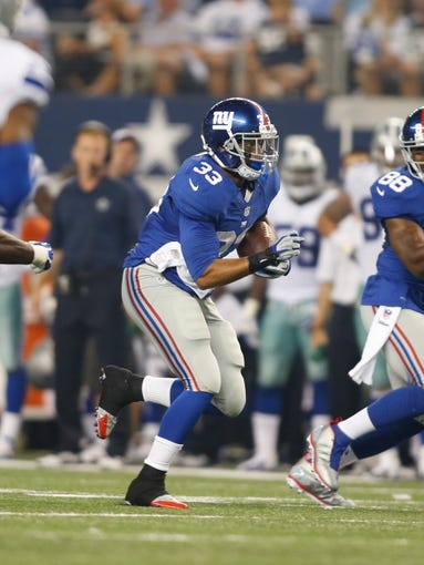 Sep 8, 2013; Arlington, TX, USA; New York Giants running back Da'Rel Scott (33) carries the ball against the Dallas Cowboys  at AT&T Stadium. The Dallas Cowboys beat the New York Giants 36-31. Mandatory Credit: Tim Heitman-USA TODAY Sports